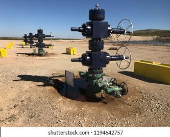 Oil Wellheads in a Row