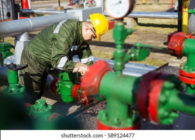 Oil worker repairing wellhead valve with the wrench