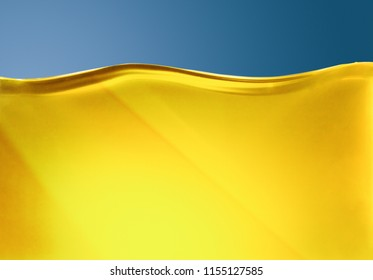Oil or yellow liquid with air bubbles at the blue background.
