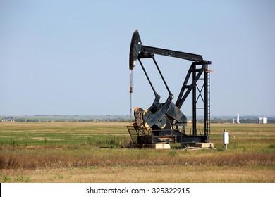 An oilfield pumpjack production on Oklahoma farmland.
