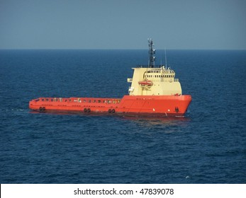 Oilfield supply vessel, at anchor awaiting assignment