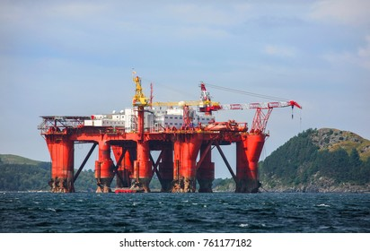 Oilplatform towed from construction site to the North Sea