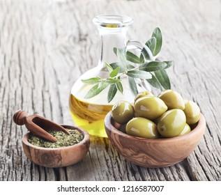 Oilve oil with oregano on wooden board