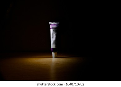 Ointment tube isolated on the dark background