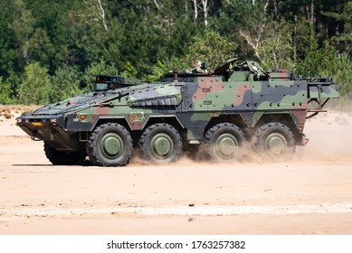 OIRSCHOT, EINDHOVEN, THE NETHERLANDS - JUNE 24, 2020: A Boxer armoured fighting vehicle of the Royal Netherlands Army is driving in the sand at the GLV-V, Oirschot.