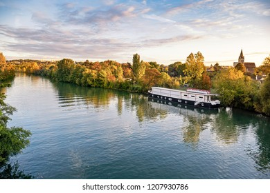 The Oise river at sunrise in autumn, Cergy Pontoise, France