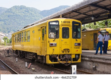 "OITA,JAPAN - MAY 29,2014 : The local train ""Y-DC125"" at Yufuin station. Y-DC125 (Yellow one man diesel car) use KiHa 125 train, operated by JR Kyushu or Kyushu railway company."