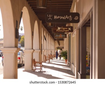 Ojai, CA / United States - October 12 2019: A day in the sun at the Ojai Days festival. Store fronts with tourist checking out the different spots.
