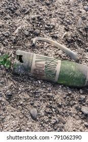 OJAI, CALIFORNIA - DECEMBER 25, 2017: Vintage soft drink bottle and animal bones revealed by Thomas Fire near Lake Casitas