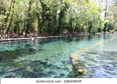 OJO DE AGUA, OMETEPE ISLAND, NICARAGUA: APRIL 9, 2018 - Unidentified tourists at the Ojo de Agua Lake, on Ometepe Island, Nicaragua.