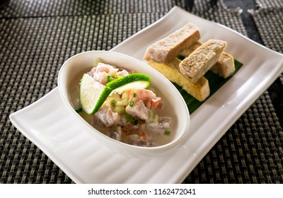 Oka - known as kokoda, poke, ceviche, or poisson cru - is Polynesian raw fish salad from Samoa, with taro chips in a restaurant