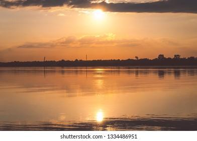 Oka River. beautiful sundown Kolomna Russia. sun reflection in water. soft sunlight