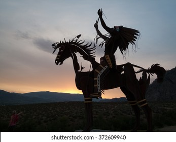 Okanagan, British Columbia,Canada -June 16,2009 : Native Sculpture at sunset  in Okanagan valley, British Columbia, Canada