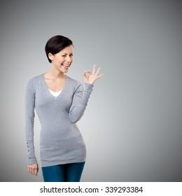 Okay gesture, isolated on grey background