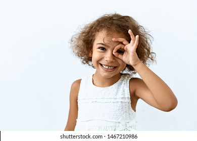 Okay symbol. Portrait of Little African American girl who a showing agree and approval sing.