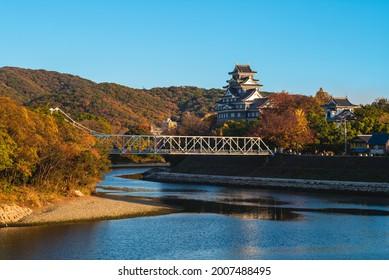 Okayama Castle, aka Ujo or crow castle, by river asahi in japan