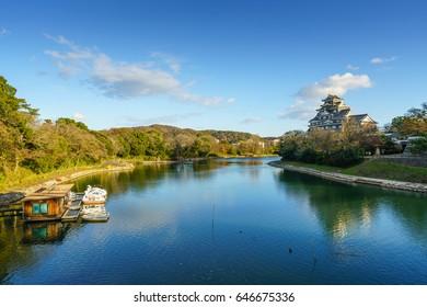 Okayama Castle (Crow Castle) on Asahi River, Okayama, Japan.