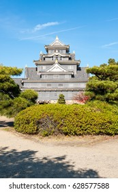 Okayama castle under the blue sky and white clouds on the sunny day.