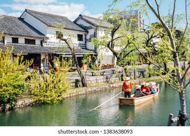 Okayama, Japan - April 15, 2019 : Old boat on canal at Kurashiki Bikan Historical Quarter