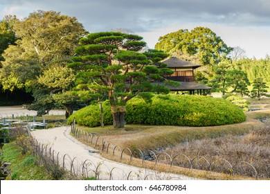 OKAYAMA, JAPAN- DEC 6 : Landscape of Koraku-en garden on Dec 6, 2016 in Okayama, Japan. It is one of the Three Great Gardens of Japan, along with Kenroku-en and Kairaku-en.