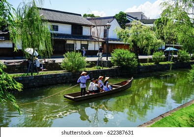 Okayama, Japan - Jun 14, 2015. Tourist boat on the canal at Kurashiki Ancient Town in Okayama, Japan. Kurashiki is a historic city located in western Okayama Prefecture.
