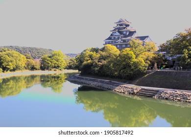 "OKAYAMA, JAPAN - NOVEMBER 4 2019: Okayama Castle's dark black facade made people call it Ujo, or the ""castle of crows."""