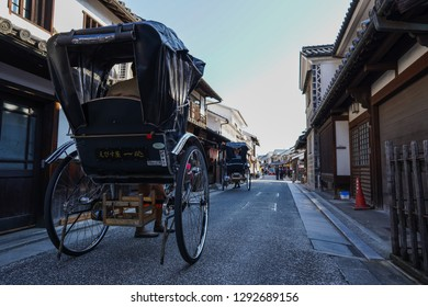 Okayama - Nov. 18, 2018: Rickshaw rider is seen carrying customer at Kurashiki