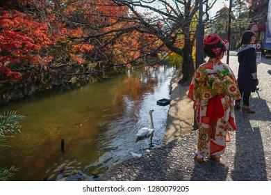 Okayama - Nov. 18, 2018: Selective focus of Japanese kid wearing kimono at Kurashiki