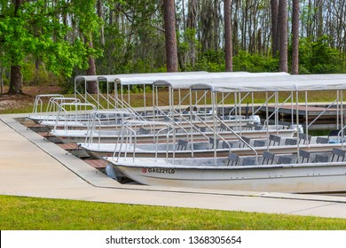 Okefenokee Swamp, Folkston, GA, USA-3/29/19: Tourist skiffs docked at the canal at eastern entrance to the swamp.