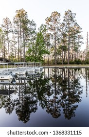 Okefenokee Swamp, Folkston, GA, USA-3/29/19: The canal at eastern entrance to the swamp, with skiffs at dock.