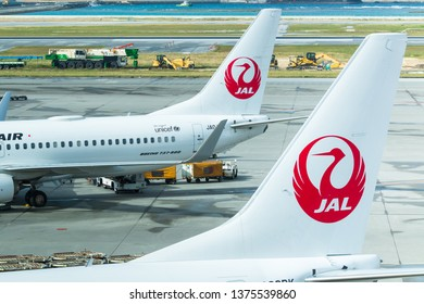 Okinawa, Japan. December 5, 2018. Tail of Japan Airlines Airplanes are Parking at Naha Airport for Boarding Passenger. Close Up.