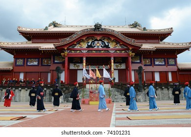 OKINAWA, JAPAN - JANUARY 1:  men walk in front of Shurijo in the ancient new year ceremony reenacted at shurijo castle on January 1, 2011 in Okinawa, Japan.