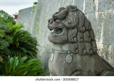 OKINAWA, JAPAN - JUNE 28, 2015: Shisa stone lion at Zuisemmon gate, Shurijo Castle.