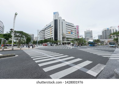 Okinawa, Japan - June 8,2019 : Street view of intersection in front of RYUBO Department Store in Naha, Okinawa, Japan on June 8,2019.