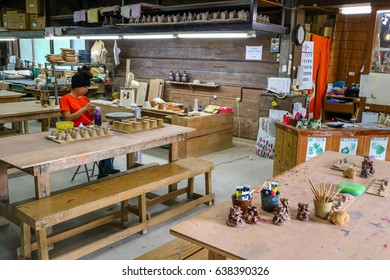 OKINAWA, JAPAN - MARCH 1, 2017 : Artist paint and work in Pottery factory in Okinawa Japan