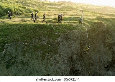 Okinawa, Japan - October 24, 2016: Unidentified people team doing rehearsal to rescue casualty at cape Manzamo Okinawa, Japan.