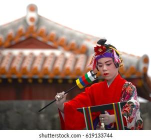 OKINAWA, JAPAN - OCTOBER 26 : Folk dance performing in Okinawa Palace taken October 26, 2013 in Okinawa.