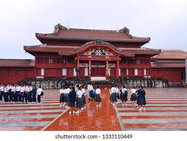 Okinawa, JP - JANUARY 31, 2018: The famous sightseeing in Okinawa, Shuri Castle or Shuri-jo, the old red vinatge castle that built by Ryukyu Kingdom, with many students in their field trip rainy day.