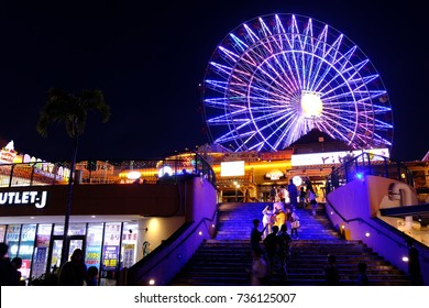 Okinawa,Japan - June 9, 2017: Night view at American Village Okinawa,  was originally intended for US military base. Now become a major commercial and shopping area.