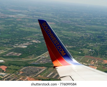 OKLAHOMA CITY, OKLAHOMA—APRIL 2017: Wing tip of a Southwest Airlines aircraft with the aerial view of Oklahoma landscape seen from the airplane window.
