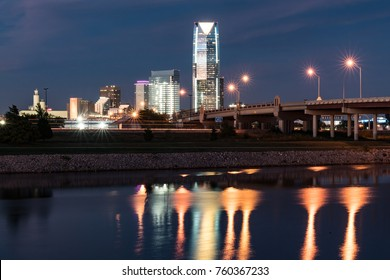 OKLAHOMA CITY, OK - OCTOBER 11, 2017: Skyline of Oklahoma City, OK at night with reflection in river