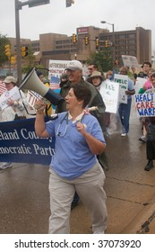 OKLAHOMA CITY, OK - SEPT. 13, 2009: Protesters march to the Oklahoma capitol building to demonstrate their support for President Obama's health care plan on September 13, 2009 in Oklahoma City, OK.