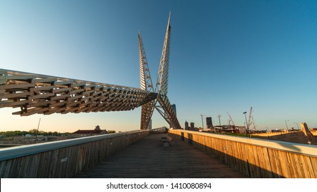 """Oklahoma City, OK / USA - 4/25/2019 : The Scissortail Bridge angles intself toward Downtown Oklahoma CIty."""