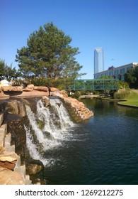 Oklahoma City, OK, USA June 9, 2015 A small waterfall graves the canal at the Bricktown district of  Oklahoma City, Oklahoma