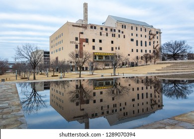 Oklahoma City, Oklahoma, United States of America - January 18, 2017. Exterior view of the Oklahoma City National Memorial Museum in Oklahoma City, OK, with reflection in the Reflecting Pool.