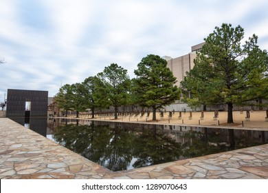 Oklahoma City, Oklahoma, United States of America - January 18, 2017. Oklahoma City National Memorial in Oklahoma City, OK, with Reflecting Pool, the Gates of Time and vegetation.