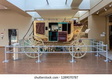 Oklahoma City, Oklahoma, United States of America - January 18, 2017. Historical stagecoach known as Concord Coach, on display at the Oklahoma History Center in Oklahoma City, OK.