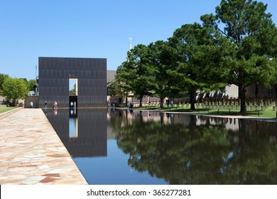 OKLAHOMA CITY, OKLAHOMA, USA - AUGUST 6, 2015: Visitors walk the grounds at the Oklahoma City National Memorial, OK, on August 6, 2015.
