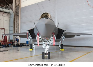 OKLAHOMA CITY, OKLAHOMA / USA - June 2, 2019: A USMC F-35B Lightning II sits on static display while being guarded at the Star Spangled Salute Air & Space Show at Tinker Air Force Base.