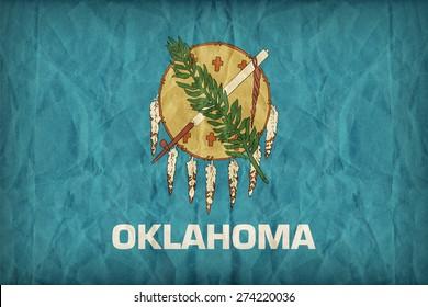 Oklahoma flag on paper texture,retro vintage style